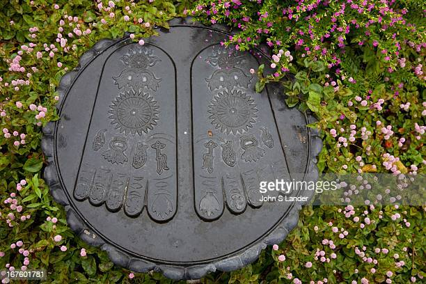 The footprints of the Buddha are venerated in all Buddhist countries They generally show all the toes to be of equal length and often bear...
