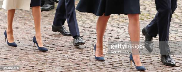 The footwear worn by Britain's Catherine Duchess of Cambridge and her husband Britain's Prince William Duke of Cambridge Britain's Prince Harry and...