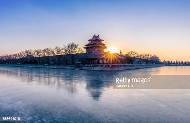 the forbidden city at dusk in winter