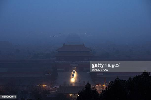 The Forbidden City is seen through heavy air pollution in Beijing on December 20, 2016. Beijing issued its first air pollution red alert for 2016 on...