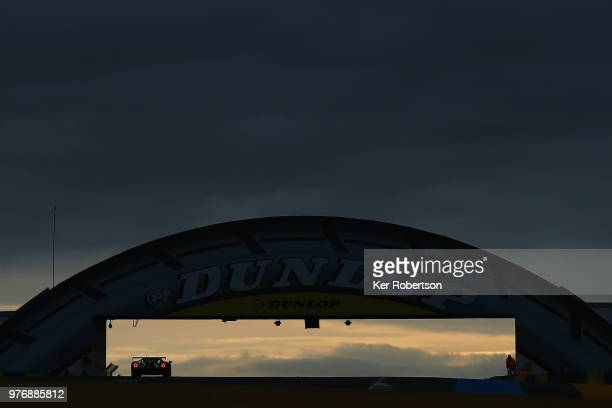 The Ford Chip Ganassi Team UK Ford GT of Stefan Mucke Olivier Pla and Billy Johnson drives under the iconic Dunlop Bridge at dawn during the Le Mans...