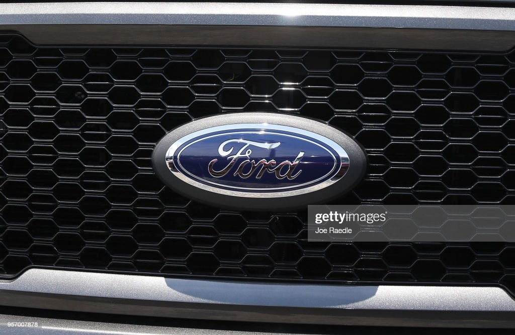 The Ford emblem is seen on the grill of a Ford F-150 pickup truck on a sales lot on May 10, 2018 in Miami, Florida. The company announced it is suspending production of its F-150 trucks after a fire at a supplier's facility caused it to run out of some parts needed in the production of the truck.