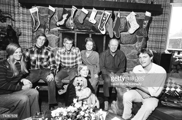 The Ford family gather for a family Christmas portrait son John Jack Ford President Gerald R Ford First Lady Betty Ford daughter Susan Ford with pet...