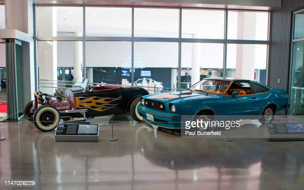 The Ford Flathead Roadster from the Iron Man movies and the Ford Mustang Ii King Cobra from Guardians of the Galaxy Vol 2 are displayed during the...