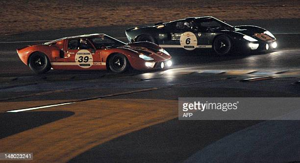 The Ford GT 40 N° 6 driven by New Zealand Roger Wills competes ahead of the Ford GT 40 N° 39 driven by Portugese Diogo Ferrao during the race devoted...