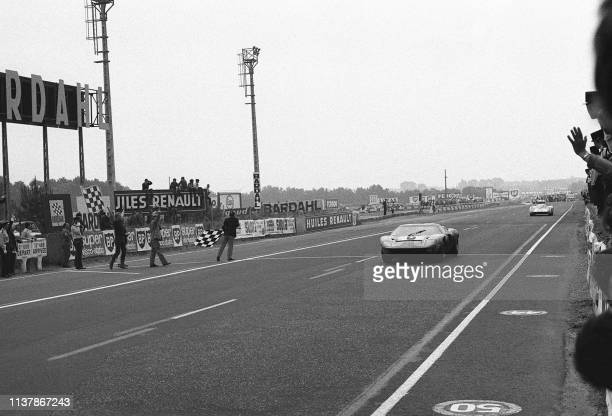 "The Ford GT 40 of the Belgian Jacky Ickx and the British Jackie Oliver wins the 37th edition of the ""24 hours of Le Mans, 15 June 1969. They arrive..."