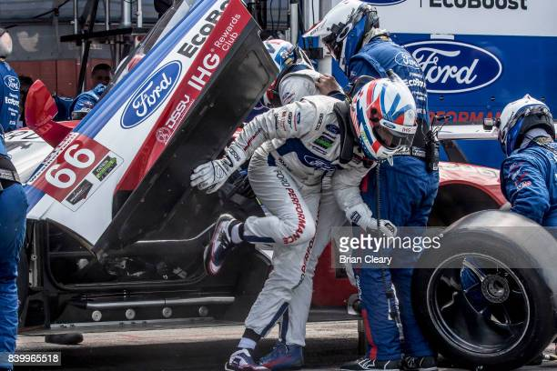The Ford GT of Joey Hand and Dirk Werner of Germany makes a pit stop during the Michelin GT Challenge WeatherTech SportsCar Series race at Virginia...