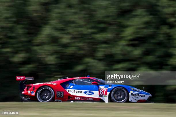 The Ford GT of Richard Westbrook of Great Britain and Ryan Briscoe of Australia races on the track during practice for the Michelin GT Challenge IMSA...