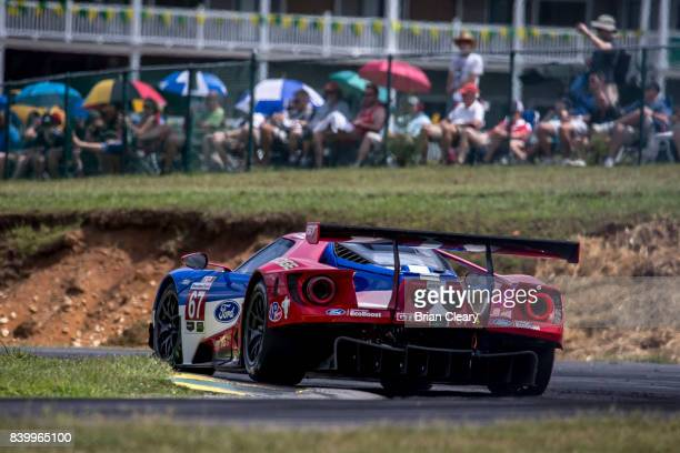 The Ford GT of Richard Westbrook of Great Britain and Ryan Briscoe of Australia races on the track during the Michelin GT Challenge WeatherTech...