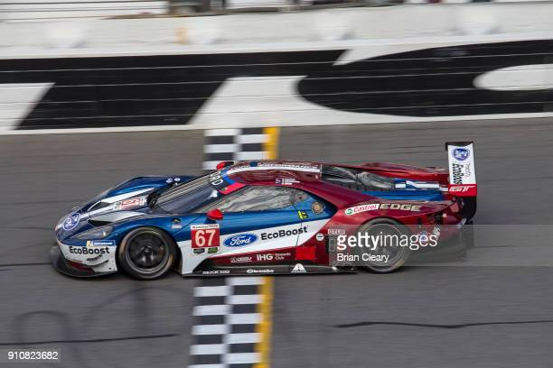 The Ford GT of Ryan Briscoe of Australia Richard Westbrook of Great Britain and Scott Dixon of New Zealand races on the track during parctice before...