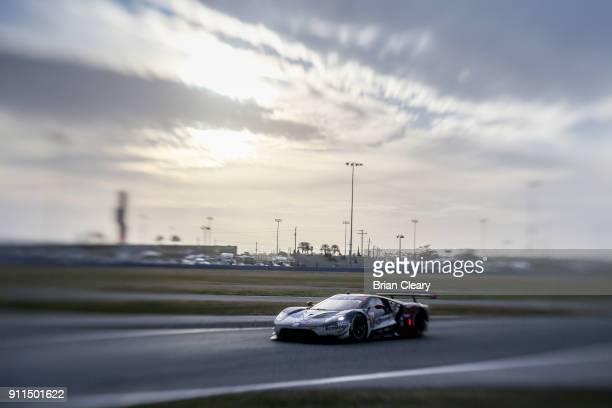 The Ford GT of Ryan Briscoe of Australia Richard Westbrook of Great Britain and Scott Dixon of New Zealand races on the track during the Rolex 24 at...