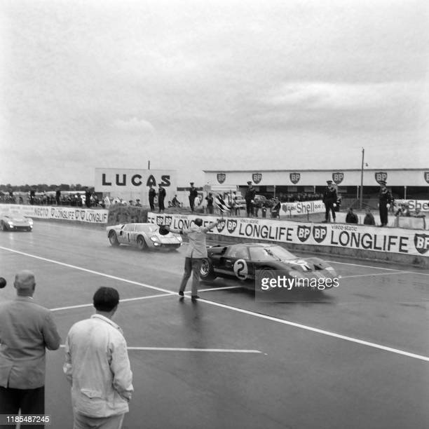 The Ford GT40 Mk II n°2 of Bruce McLaren and Chris Amon crosses the finish line and wins the 34th edition of the 24 Hours Le Mans endurance race on...