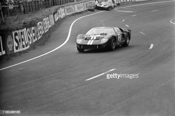 The Ford GT40 Mk II n°2 of New Zealand race car drivers Bruce McLaren and Chris Amon runs on Le Mans circuit on June 19 a few moments before winning...