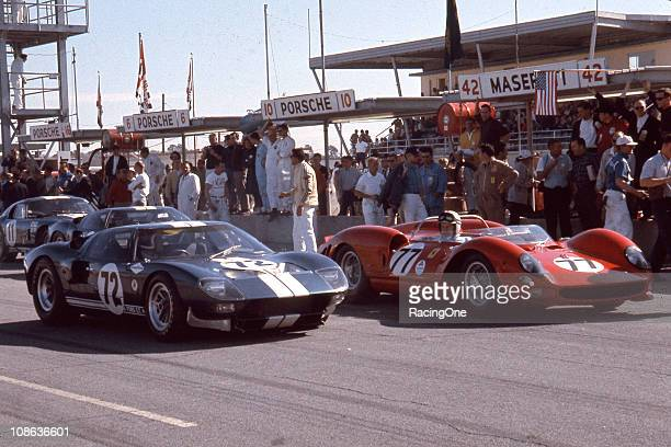 The Ford GT40 of Bob Bondurant and Richie Ginther sits on pit road before the start of the Daytona Continental at Daytona International Speedway The...