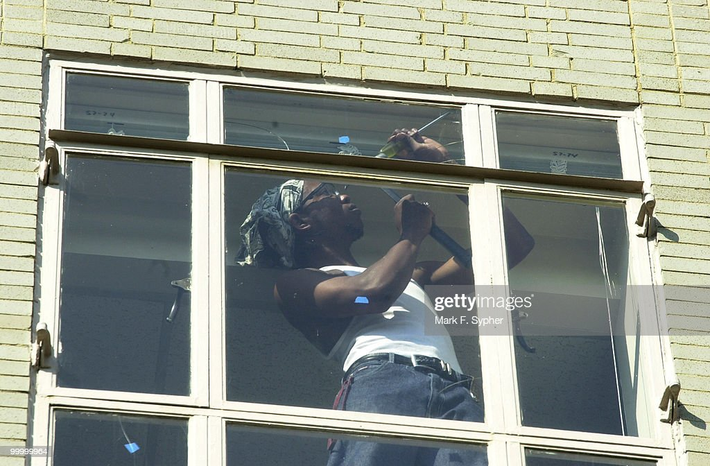 The Ford House Office Building, at 3rd and D St. SW, has had some of its' windows prepped for a shatter-resistant film, for fear that a bomb's explosion could cause flying shards of glass to injur employees inside the building. Here, a worker cleans a payne before the window is treated.