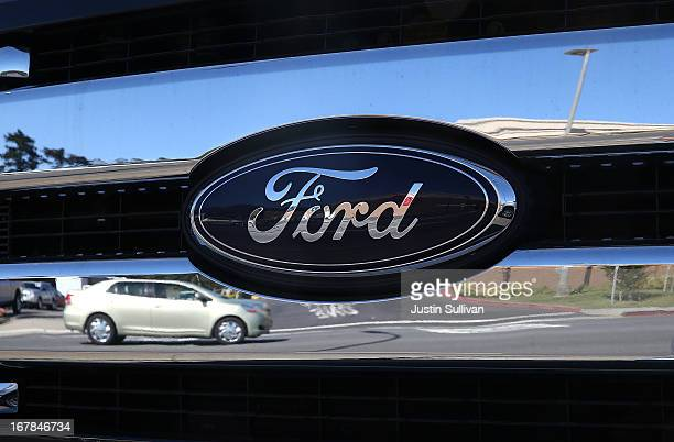 The Ford logo is displayed on the grill of a brand new truck on the sales lot at Serramonte Ford on May 1 2013 in Colma California Ford Motor Co...