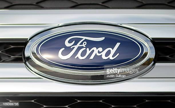 The Ford logo is displayed on the grill of an F150 pickup truck on the sales lot at Serramonte Ford on February 23 2011 in Colma California Ford...
