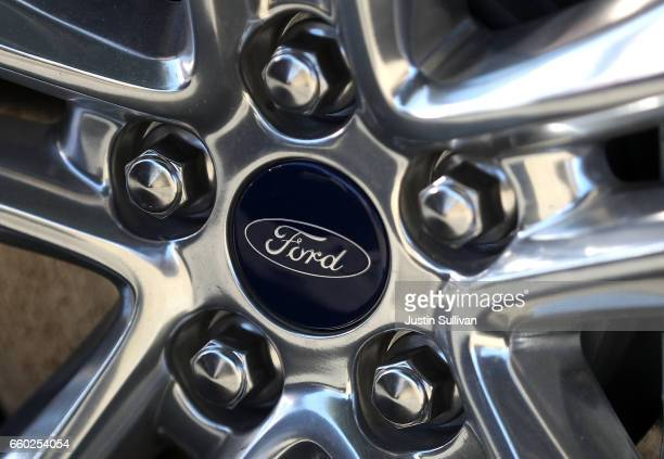 The Ford logo is displayed on the wheel of a new Ford car on the sales lot at a Ford dealership on March 29 2017 in Colma California Ford announced...