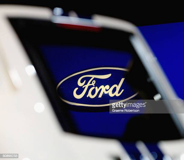 The Ford logo is seen throw the Ford GT's window at Fords biggest ever Stand at the Sunday Times Motor Show Live, May 25, 2004 in Birmingham,...