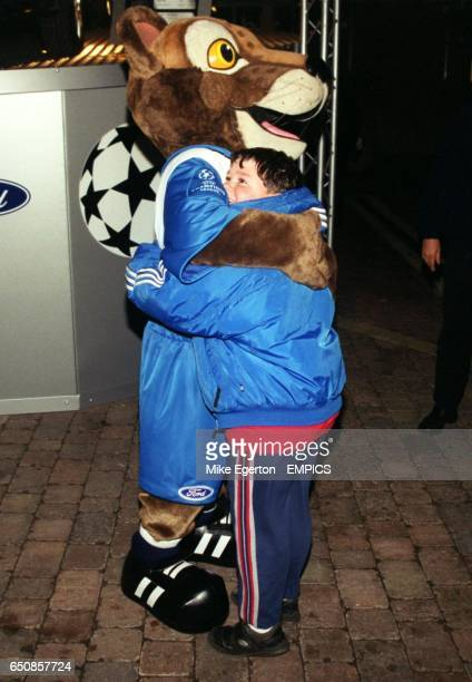 The Ford mascot hugs a young Chelsea fan