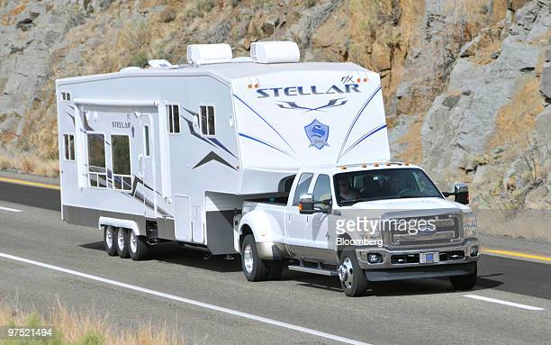The Ford Motor Co 2011 F350 Super Duty Power Stroke diesel pickup truck pulls a 24000pound camping trailer up a grade during a media test drive in...