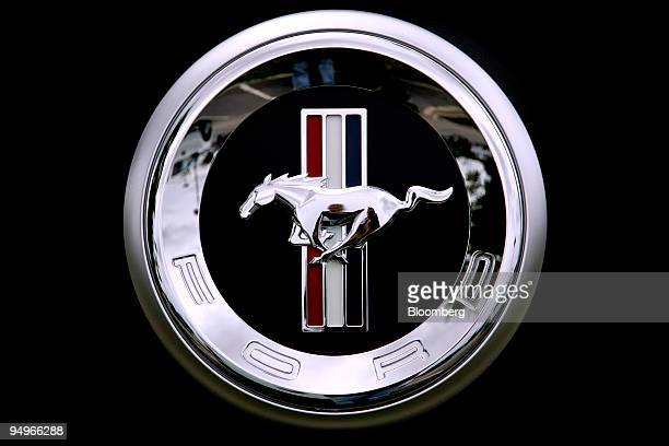 The Ford Mustang logo is displayed on the grill of a Mustang at Crossroad Ford dealership in Wake Forest North Carolina US on Sunday Aug 2 2009 Ford...