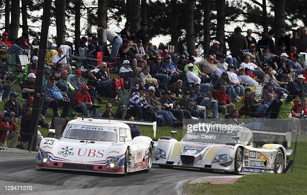 The Ford Riley of Mark Blundell and Zak Brown races past a hillside of fans during the EMCO Gears Classic at MidOhio Sports Car Course on September...
