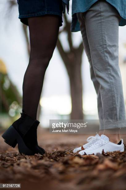 the foreground of the legs of a couple of boyfriends. - kissing feet stock pictures, royalty-free photos & images