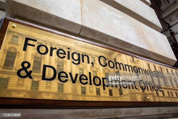 The Foreign and Commonwealth Office brass plaque sign outside the office building on King Charles Street on the 8th of September 2020 in Westminster,...