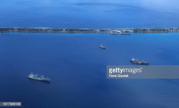 The foreign fishing motherships wait in the lagoon for their catch on August 15 2018 in Funafuti Tuvalu The small South Pacific island nation of...