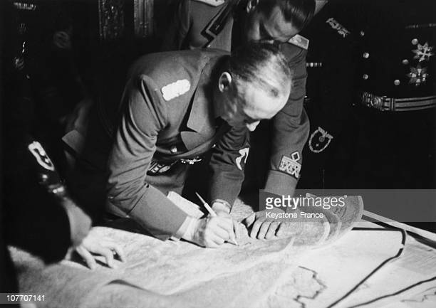 The Foreign Minister Joachim Von Ribbentropp Tracing On A Map The New Border Of Czechoslovakia Invaded By The Nazi Germany Vienna Austria