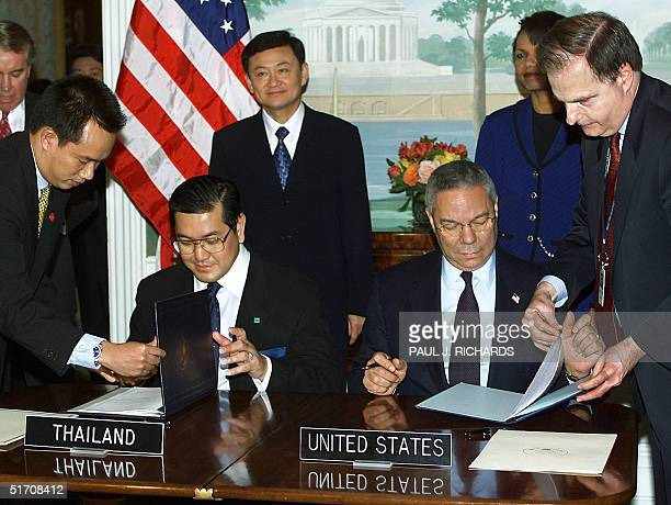 The Foreign Minister of Thailand Surakiart Sathirathai and US Secretary of State Colin Powell sign Economic Cooperation Framework documents as...