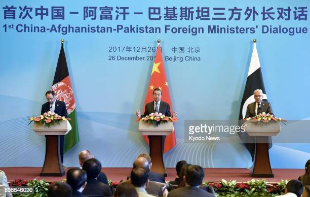 The foreign ministers of China Afghanistan and Pakistan Wang Yi Salahuddin Rabbani and Khawaja Asif meet the press at the Diaoyutai state guesthouse...