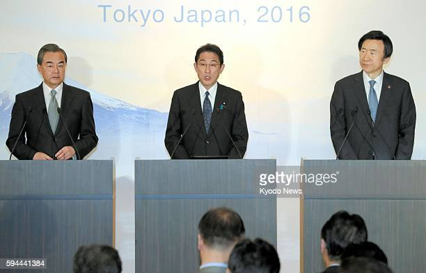 The foreign ministers of China, Japan and South Korea -- Wang Yi, Fumio Kishida and Yun Byung Se -- attend a joint press conference following their...