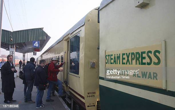 The foreign tourists board a special Heritage train powered the steam engine Akbar as it leaves from Delhi Cant station to Alwar on January 14 2012...