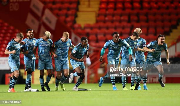 The Forest Green Rovers team celebrate winning a penalty shoot out during the Carabao Cup First Round match between Charlton Athletic and Forest...