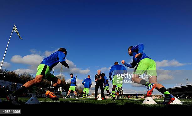 The Forest Green Rovers team warm up ahead of the FA Cup first round match between Forest Green Rovers and Scunthorpe United at The New Lawn on...