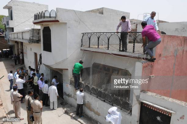 The forest officials use nets to cover the house so that the leopard could not escape in Durga colony Sohna on April 27 2017 some 25 km from Gurgaon...