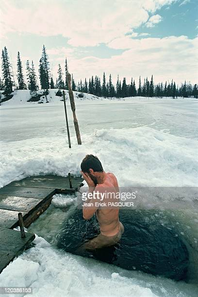 The forest people in Alaska United States The Johnston family goes for a dip in the frozen lake after having been in the sauna