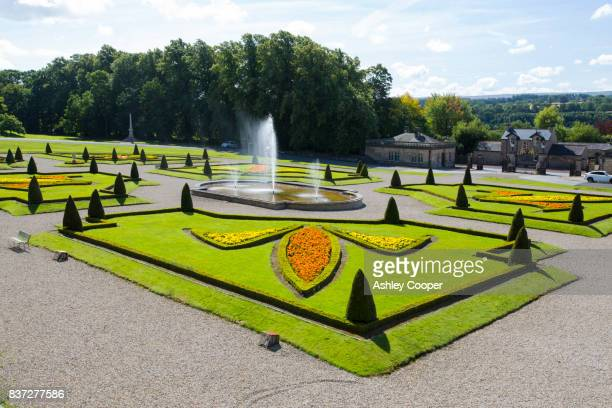 the formal gardens infornt of the famous bowes museum in barnard castle, county durham, uk. - barnard castle stock pictures, royalty-free photos & images