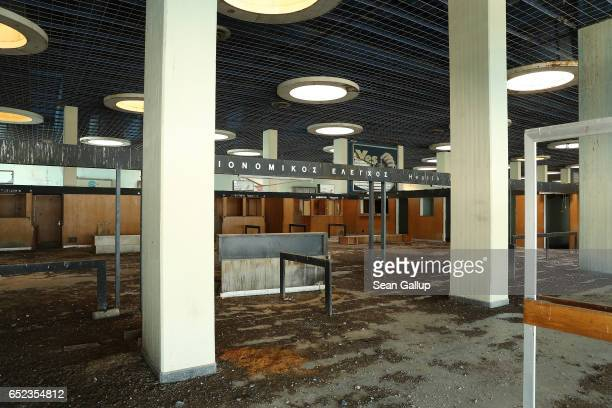 The former arrivals hall in the main terminal at Nicosia International Airport stands decaying inside the buffer zone on the southern, Greek side of...