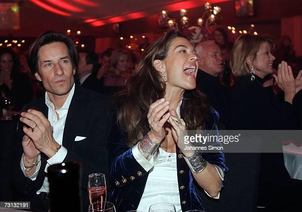 The former Austrian finance minister KarlHeinz Grasser and his wife Fiona Swarovski attend the Kitzrace Party January 27 in Kitzbuehel Austria