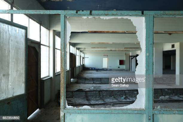 The former baggage claim hall at Nicosia International Airport stands decaying inside the buffer zone on the southern, Greek side of the divided city...