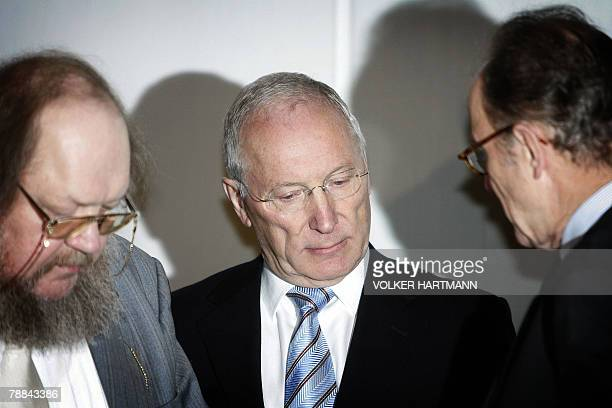 The former chairman of German public sector bank WestLB Juergen Sengera is flanked by his lawyers Christian Richter and Eberhard Kempf as he waits...