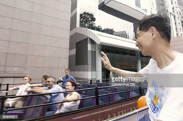 The former chairman of the Democratic Party Martin Lee and prodemocracy legislators and lawmakers parade on an open top bus in Hong Kong 13 May 2004...