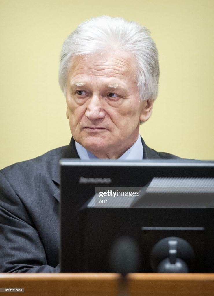 The former chief-of-staff of the Yugoslav Army, Momcilo Perisic, sits on February 28, 2013 during his appeal judgement in a courtroom of the Yugoslav War Crimes Tribunal (ICTY) in The Hague. The UN war crimes court sentenced Perisic to 27 years in jail on Sepember 6, 2011 for helping the Bosnian Serb army murder and persecute Bosnian Muslims, including at Srebrenica in 1995.