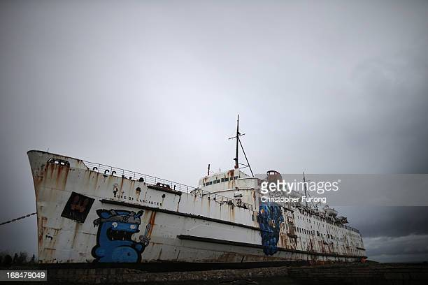 The former cruise ship The Duke of Lancaster sits in it's dry dock adorned with graffiti on May 9 2013 in Flint Wales The ship locally known as the...