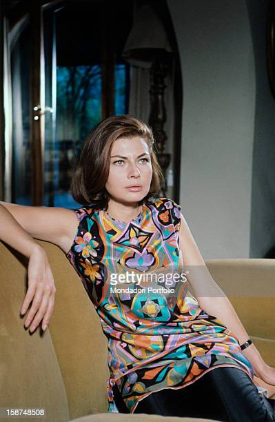 The former empress of Persia Soraya , the second wife and Queen Consort of the late Shah of Iran, is seated on a sofa and looking thoughtful. Rome ,...