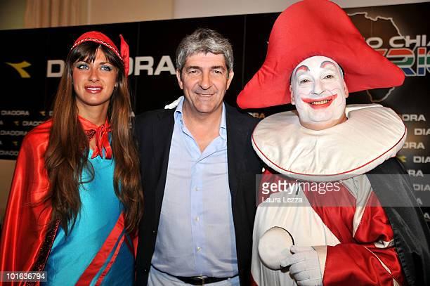 The former football player and World Champion Paolo Rossi poses with the Burlamacco symbol of the Carnival of Viareggio attend 'Viareggio calls South...