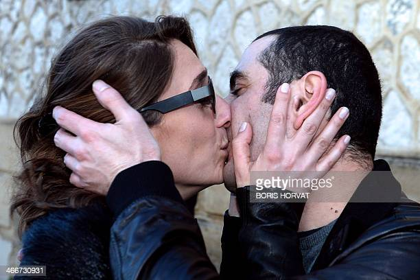 The former Georgian minister of Defence David Kezerachvili embraces his wife Sophia as he leaves the Baumettes prison in Marseille on February 3 2014...